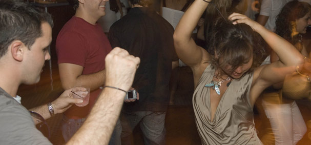 A girl shows her rhythm to the music played by the dj on the dance cruise in Miami.