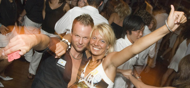A couple is caught taking a selfie on the dance cruise.