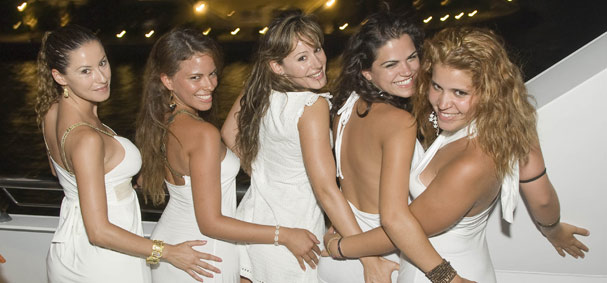 Five girls pose for the camera dressed in white for the dance cruise.