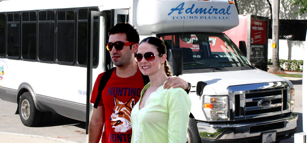 A couple poses infront of the tour buses.