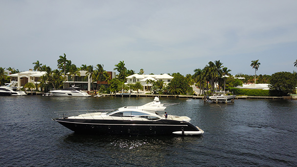 A profile view of the Black Ice - the best yacht charter in Miami.