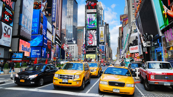 The bus tour takes you through Time Square in NYC.