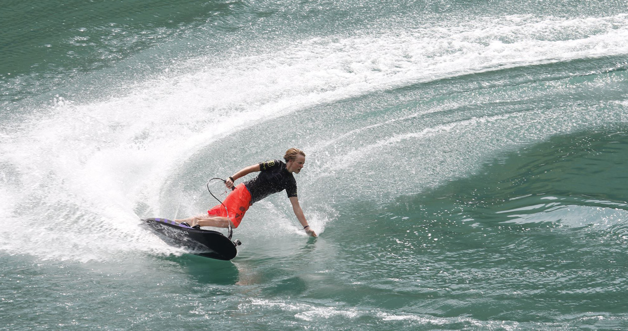 A young kid shreds on his Jetsurf