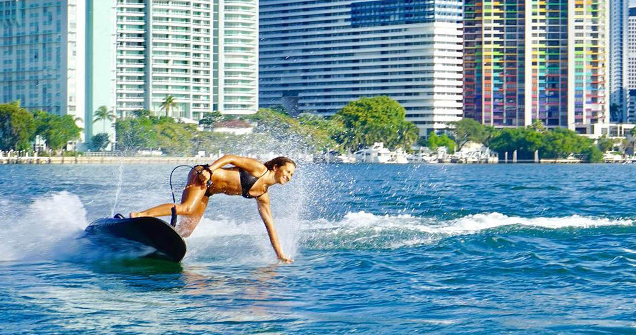 A professional women pilot rips on the water in Miami