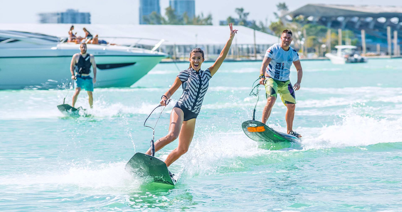 It is all fun for these jetsurf riders in Miami.