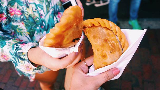 Enjoy a tasty empanada during your Little Havana food tour.