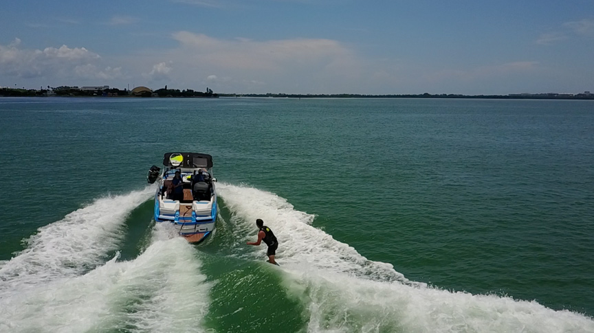 An aerial shot of a wake surfing in Biscayne Bay with Miami Wake Academy.