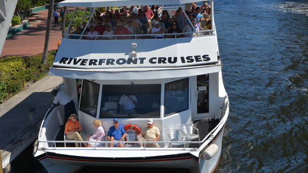 A private group takes a sightseeing cruise along the New River in Fort Lauderdale.