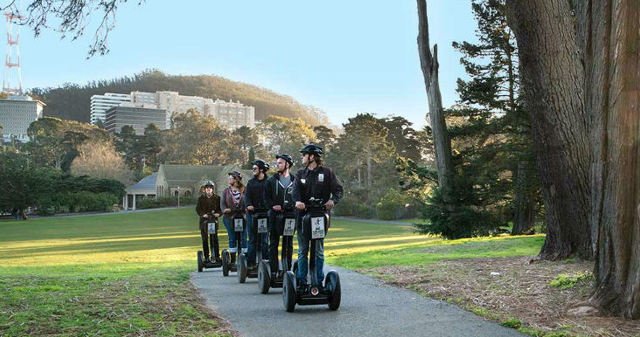 A group poses for a picture on their Segway tour of San Francisco.