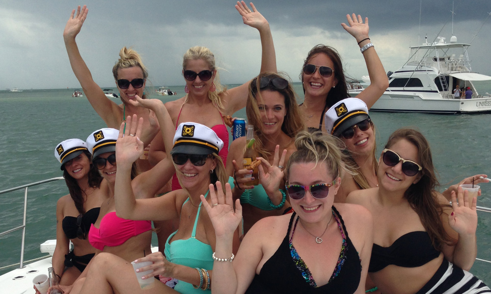 A group of ladies pose for a picture on the White Ice yacht in Miami.
