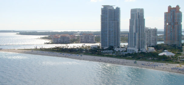 A day at the beach is made incredible by taking a parasailing adventure over Miami Beach.