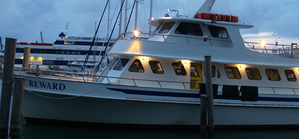 The public fishing boat is getting ready for its 8 pm departure.