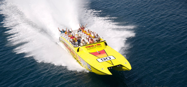 Passengers wave to the camera as the Thriller Speedboat races around Miami.